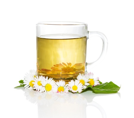 remedy: Fresh herbal tea or infusion, from Bellis prennis, for naturally detoxifying the body in the springtime Stock Photo