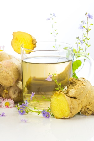 fresh ginger: Fresh herbal tea or infusion with root ginger and herbs, used to aid weight loss and detoxifying Stock Photo
