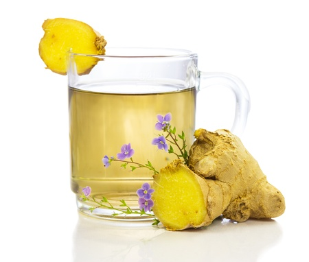 botanical remedy: Healthy, herbal tea or infusion, of fresh root ginger, on a white background Stock Photo