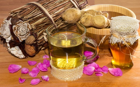 Sweet and healthy herbal infusion or tea with root ginger and honey used in alternative medicine. photo