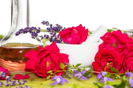 Essntial Oil and roses in a mortar photo