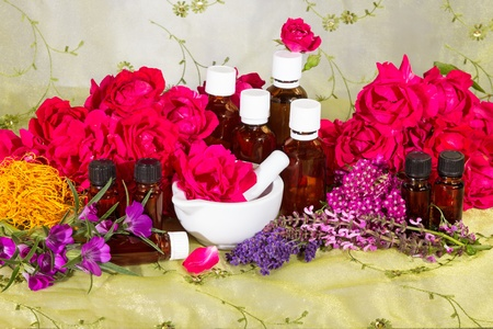 Essential oil with roses and herbs photo