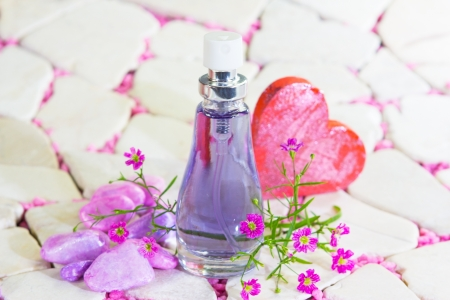 atomiser: Pretty bottle of blue perfume or natural essence with flowers