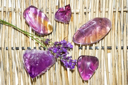 Amethyst and ametrine polished gemstones and a crystal which are important metaphysical stones and referred to as the sobriety stone as they aid in overcoming addictions, also birthstone for March Stock Photo - 21462295