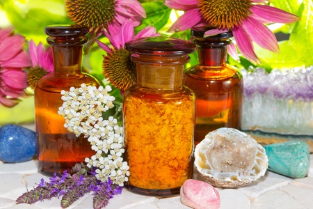 Naturopathy with gemstones for crystal healing and flowers including lavender and echinachea for alternative medicine with essential oil , plant extracts and dried plants for aromatherapy