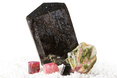 trigonal: Collection of different Tourmaline crystals including schorl, rubellite and watermelon tourmaline used as a gemstone in jewellery and crystal healing to promote the electrochemistry of the body Stock Photo