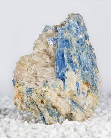 throat chakra: Blue kyanite blades in matrix, an aluminium silicate with perfect cleavage used as an important refrectory in industry and to treat throat disorers and promote loyalty in metaphysics Stock Photo