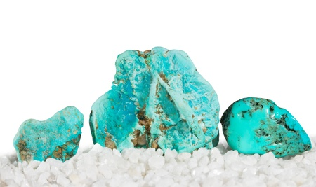 Polished and rough turquoise, the Master Healing Stone which relieves stress and derives its blue colour from copper, making it popular in jewellery Stock Photo - 21609638