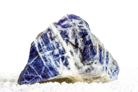 Sodalite, a popular mineral in jewellery for its blue colour and a constituent of lapis luzuli, it is used in crystal healing for efficiency, love and treatment of diabetes and the lymph glands Stock Photo - 21609639