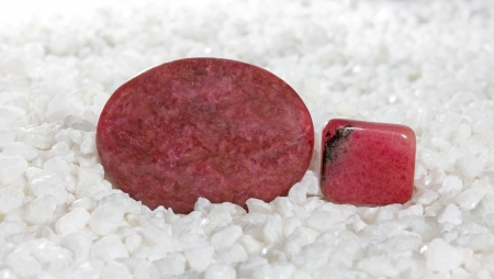 mineralogy: Polished pink to rose-red rhodonite cabochons, a manganese silicate used as an ornamental stone fro carving and jewellery and for the treatment of emphysema and joint inflammation