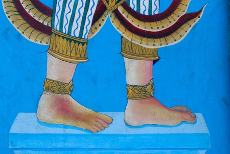 anklet: painting of barefoot with anklet on blue wall in wat yai intaram, chonburi Thailand