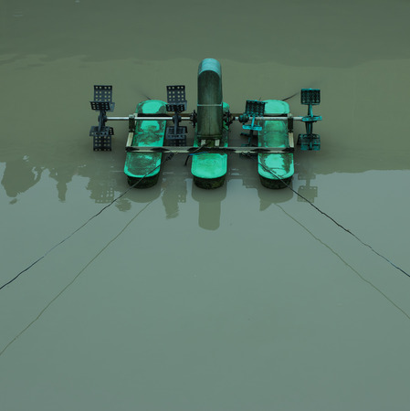 aeration: green aeration turbine floating on the water for oxygen feeling