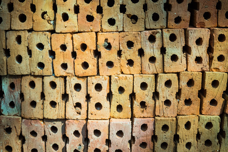 clay brick: pile of orange baked clay brick Stock Photo