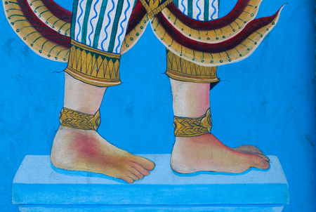 painting of barefoot with anklet on blue wall in wat yai intaram, chonburi Thailand