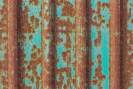 dirty and rusty brown color on green zinc plate wall for background