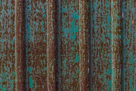demolish: dirty and rusty brown color on green zinc plate wall for background