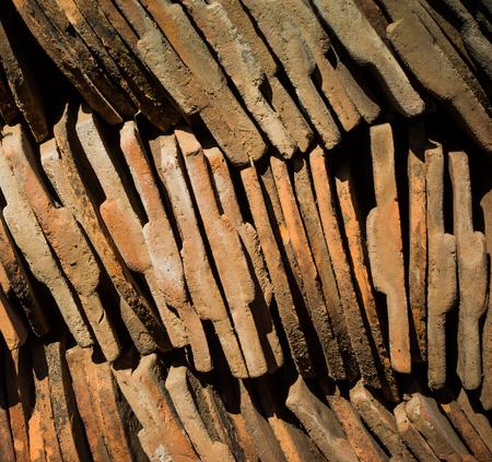 close-up stack of old orange roof tile