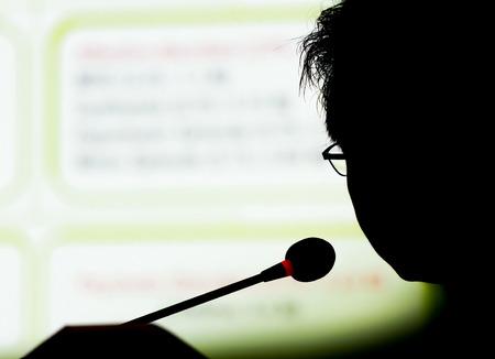silhouette speaker on presentation with slide