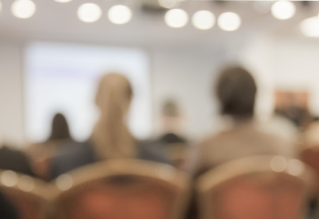Blurred image of people in auditorium , blur with bokeh