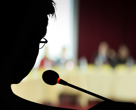 silhouette   speaker on  presentation or meeting  with  audience