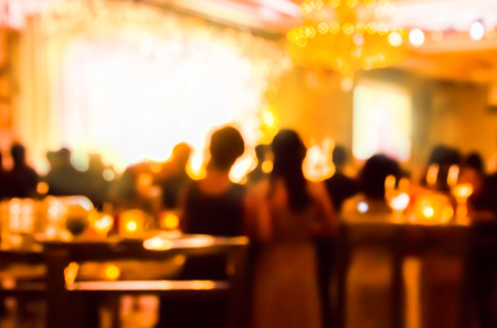 blur people and waiter on gala dinner party in ballroom