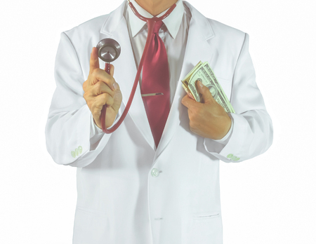 unethical: Isolated image of Doctor with stethoscope and money in hand, white background Stock Photo