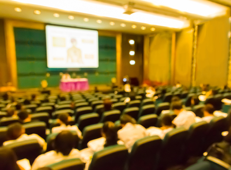 Blur  audience  in hall or  auditorium or   classroom ,brown  color