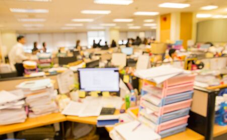 blurred office worker  busy working with messy document