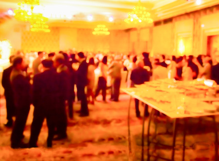blurred  people on cocktail party  in   hotel ballroom Stock Photo