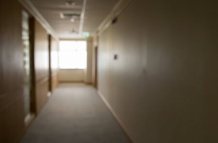 blurred corridor and window in office building