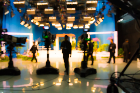 blurred silhouette cameraman with  staff in TV studio station Archivio Fotografico