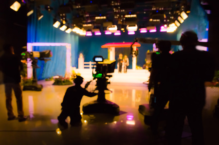 blurred silhouette cameraman with  staff in TV studio station Stock Photo