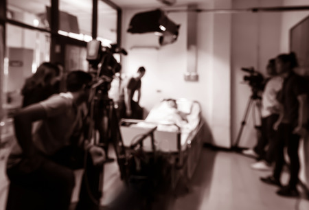 blurred silhouette cameraman with  staff  and actor in acting Stock Photo