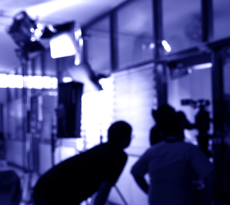 blurred silhouette cameraman with   staff  in acting