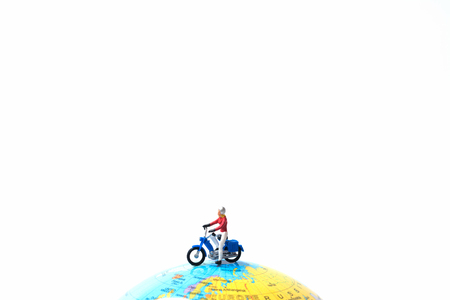 delivery truck: Tiny miniature model of the man is riding the motorbike or motorcycle on globe using as travelling, journey, travel to destication background concept.