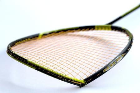 Broken badminton racket isolated on white