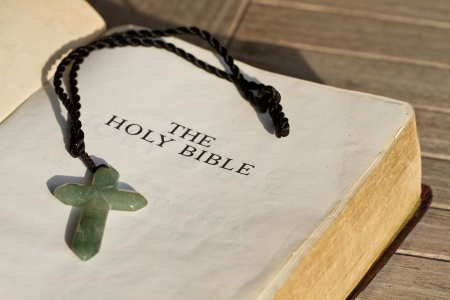 monotheism: The Holy Bible and the cross Stock Photo