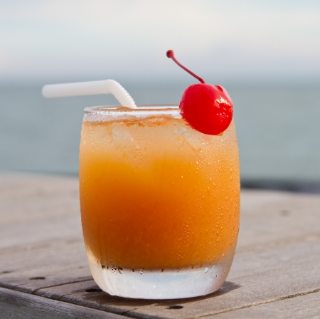 Relax with a mocktail by the beach photo