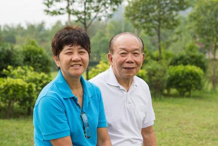 Happy senior couple at the park photo