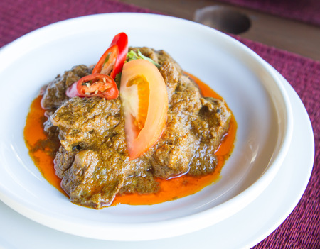 beef curry: Rendang Daging - Dried beef curry with coconut milk and spices.