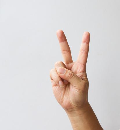 平和や勝利のシンボルを 2 本の指を持つ手です。 写真素材