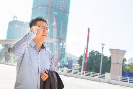 Asian businessman with construction site background photo
