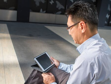 Asian businessman on tablet computer