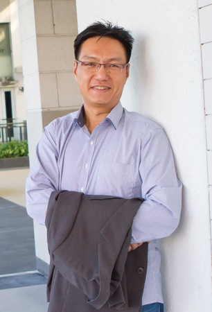 Portrait of a smiling and successful chinese man photo