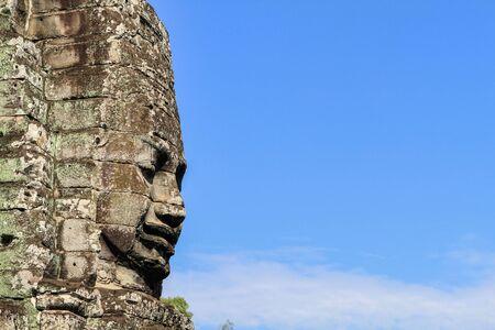 bayon: Ancient stone faces of Bayon temple, Cambodia