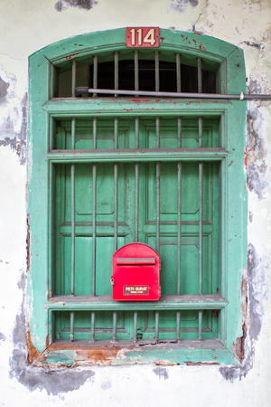letter box: Green windows with red letter box Stock Photo