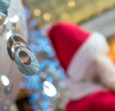 dangling: Christmas sparkling dangling decoration on Santa Claus background