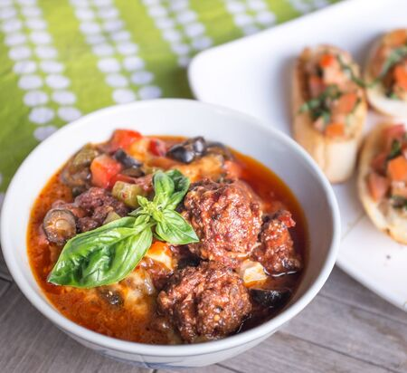 meaty: Beef meatballs with tomatoes hot stew top with basil Stock Photo