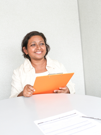 office environment: Professional working Indian female in office environment Stock Photo