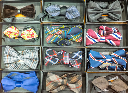 dozen: Dozen of various colors of bow ties Stock Photo
